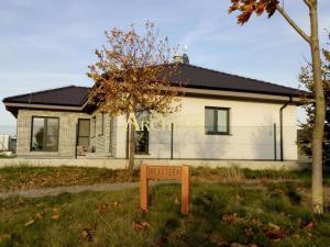 5 izbový rodinný dom, novostavba v Hrubej Borši, výhľad na golf