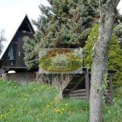 Stavebný pozemok 718 m2, s chatkou v Nízkych Tatrách pod Chopkom -  Cena 18 000 €