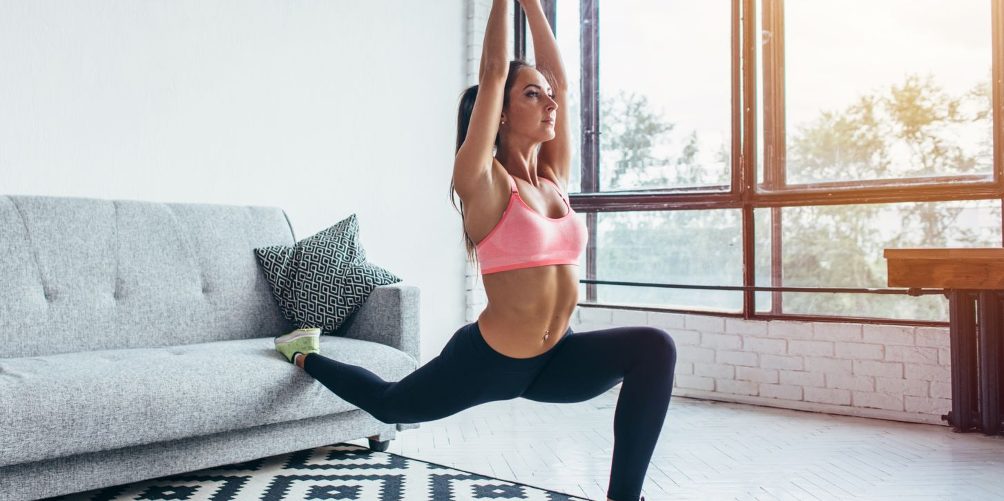Fit woman doing front forward one leg step lunge exercises workout