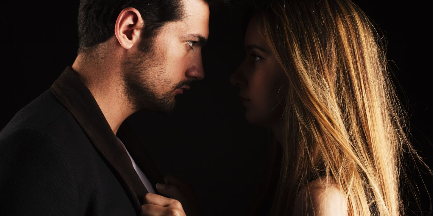 Couple looking fiercely into each other's eyes